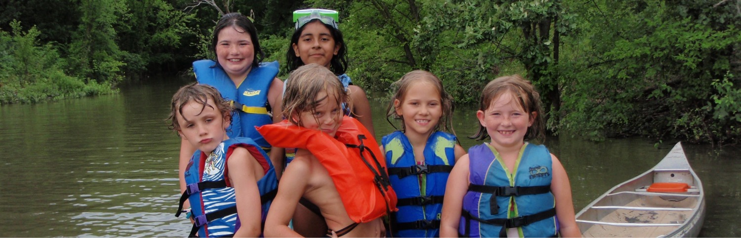 Children in life vests about to go canoeing
